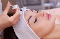 The doctor cosmetologist makes the Botulinotoxin injection procedure for tightening and smoothing wrinkles on the face skin Stock Images