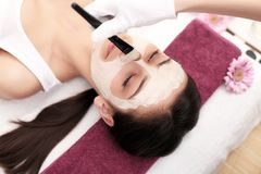 The doctor is a cosmetologist for the procedure of cleansing and Royalty Free Stock Images