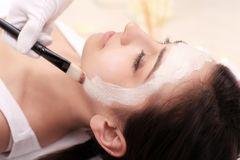The doctor is a cosmetologist for the procedure of cleansing and Royalty Free Stock Photos