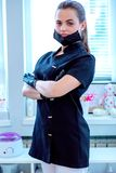Doctor cosmetologist in a protective black face mask. Female doctor cosmetologist in protectively black face mask royalty free stock images