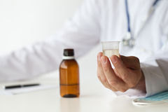 Doctor With Cough Syrup Stock Image