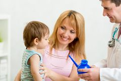Doctor counseling mother and boy about nasal Stock Photo
