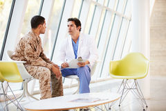 Doctor Counselling Soldier Suffering From Stress. In Hospital Royalty Free Stock Photos