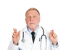 Doctor crossing fingers Stock Image