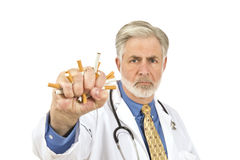 Doctor Crushing Cigarettes Royalty Free Stock Photo