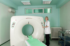 Doctor in CT (CAT) scanner room Royalty Free Stock Images
