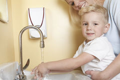 Doctor with a cute little boy wash hand Stock Images