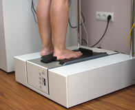 Doctor 3D scanning patient's foot Royalty Free Stock Photo