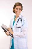 Doctor de alta tecnología en una PC de la tablilla Foto de archivo libre de regalías