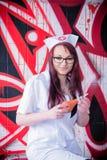 Doctor de la mujer con el bulbo II del enema Fotografía de archivo libre de regalías
