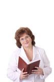 Doctor de la mujer con el cuaderno Imagen de archivo libre de regalías