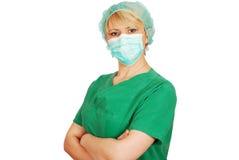 Doctor de la mujer con la máscara Imagen de archivo