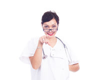 Doctor de sexo femenino acertado que señala algo Fotos de archivo