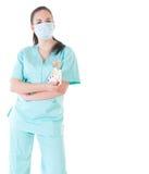 Doctor de sexo femenino del cirujano que sostiene el dinero Imagenes de archivo