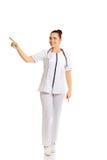 Doctor de sexo femenino que señala a la izquierda Foto de archivo libre de regalías