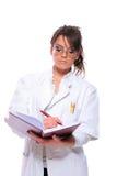 Doctor de sexo femenino que sostiene un cuaderno Fotos de archivo