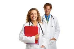 Doctor de sexo femenino y de sexo masculino amistoso feliz imagenes de archivo