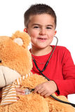 Doctor del niño pequeño con el oso de peluche Imagen de archivo