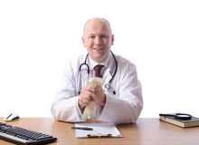 Doctor at desk Stock Photo