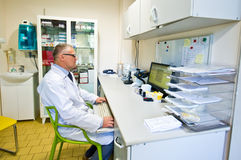 Doctor at desk in lab Royalty Free Stock Photos
