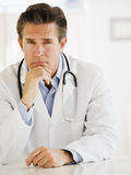 Doctor at desk in office Royalty Free Stock Photography