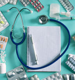 Doctor desk workplace stethoscope spiral notebook Stock Photo