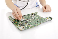 Doctor determines the main board problem. Stock Photos