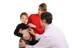 Doctor Diagnoses The Little Boy Stock Photo