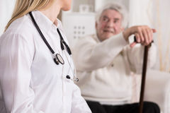 Doctor diagnosing disabled man Stock Photos