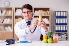 The doctor in dieting concept with fruits and vegetables Royalty Free Stock Photo