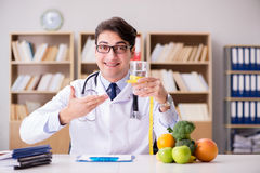 The doctor in dieting concept with fruits and vegetables Royalty Free Stock Photography