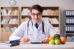 The doctor in dieting concept with fruits and vegetables Royalty Free Stock Photos