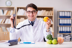 The doctor in dieting concept with fruits and vegetables Stock Photos