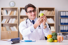 The doctor in dieting concept with fruits and vegetables Stock Image