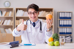 The doctor in dieting concept with fruits and vegetables Royalty Free Stock Image