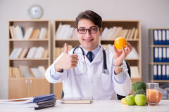 The doctor in dieting concept with fruits and vegetables Stock Photography