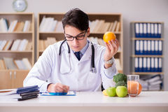 The doctor in dieting concept with fruits and vegetables Royalty Free Stock Images