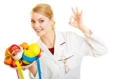 Doctor dietitian recommending healthy food. Diet. Royalty Free Stock Photography