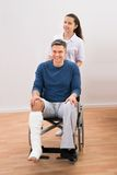 Doctor with disabled patient on wheelchair Royalty Free Stock Photography
