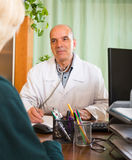 Doctor discharging  female patient Royalty Free Stock Images