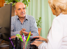 Doctor discharging patient from hospital Stock Photography