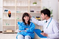 The doctor discussing blood transfusion with patient. Doctor discussing blood transfusion with patient Stock Photography