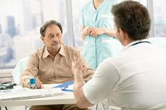 Doctor discussing diagnosis with patient Stock Photos