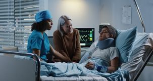 Doctor discussing diagnosis with patient and his relative. Medium shot of a female doctor discussing diagnosis with teenage male patient and his mother royalty free stock photo