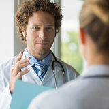 Doctor discussing with female colleague Royalty Free Stock Photo