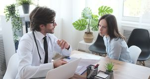 Doctor discussing about medical report with woman