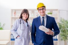 The doctor discussing new hospital plan with architect Stock Image