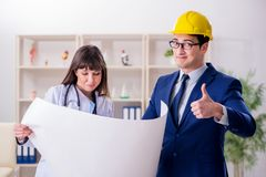The doctor discussing new hospital plan with architect. Doctor discussing new hospital plan with architect stock image