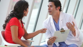 Doctor Discussing Notes With Female Patient Royalty Free Stock Image
