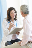 Doctor Discussing With Patient In Clinic Royalty Free Stock Image